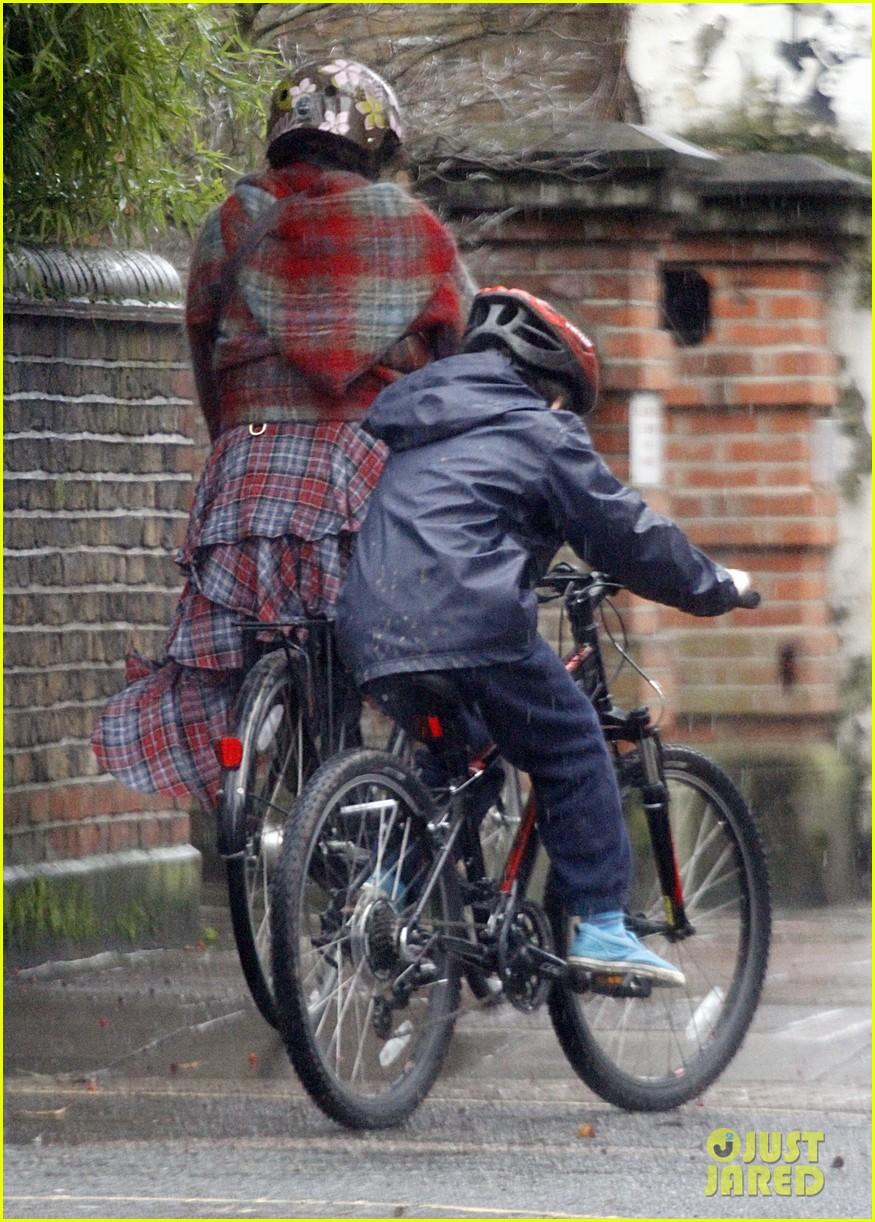 helena bonham carter bikes in the rain with son billy 053022108