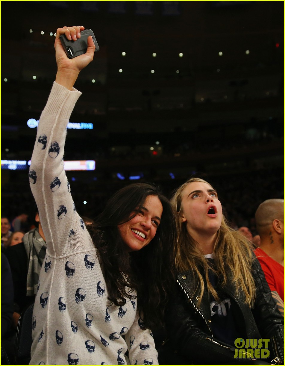 cara delevingne michelle rodriguez go in for kiss at knicks game 053025261