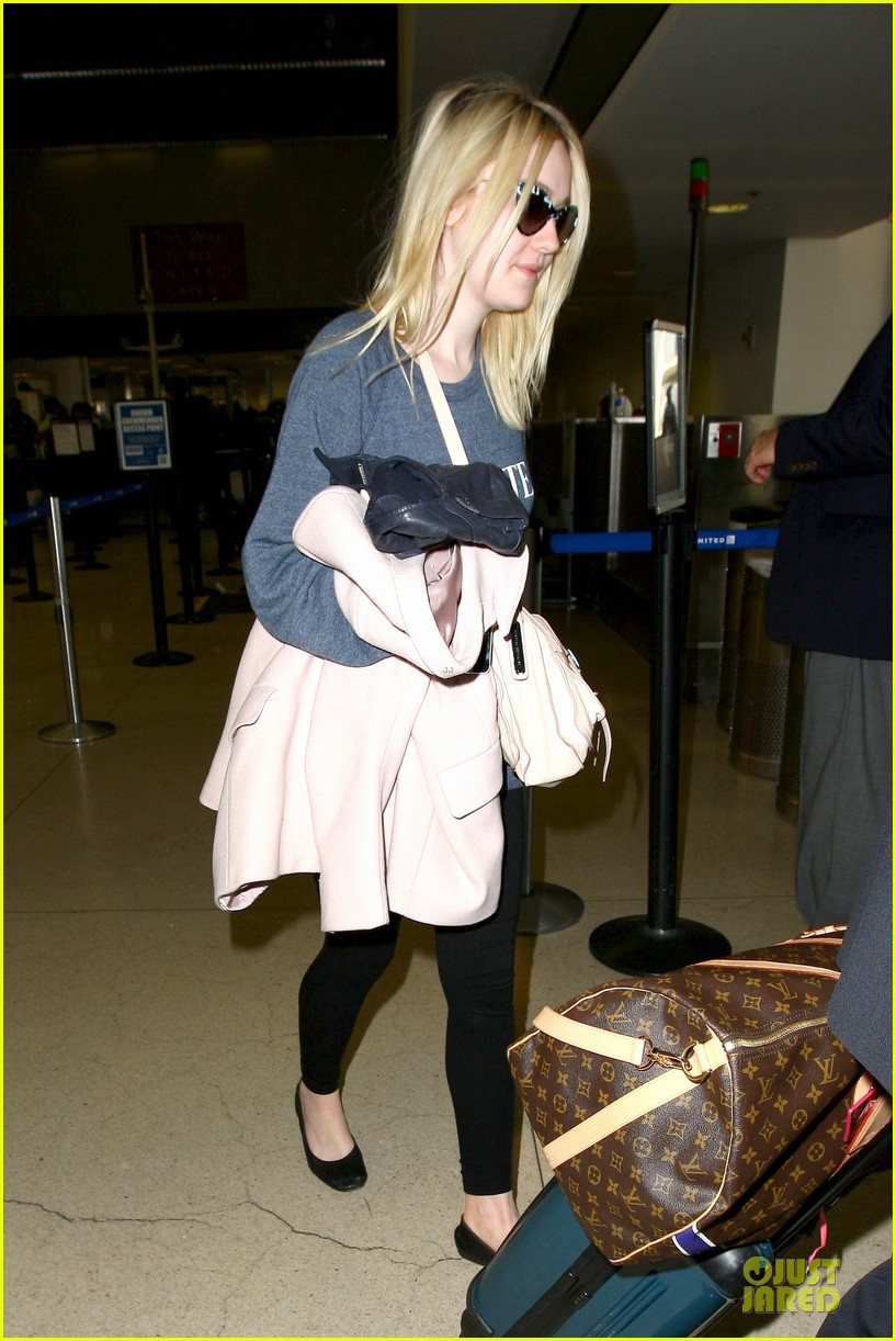dakota fanning ends january with casual lax airport landing 12