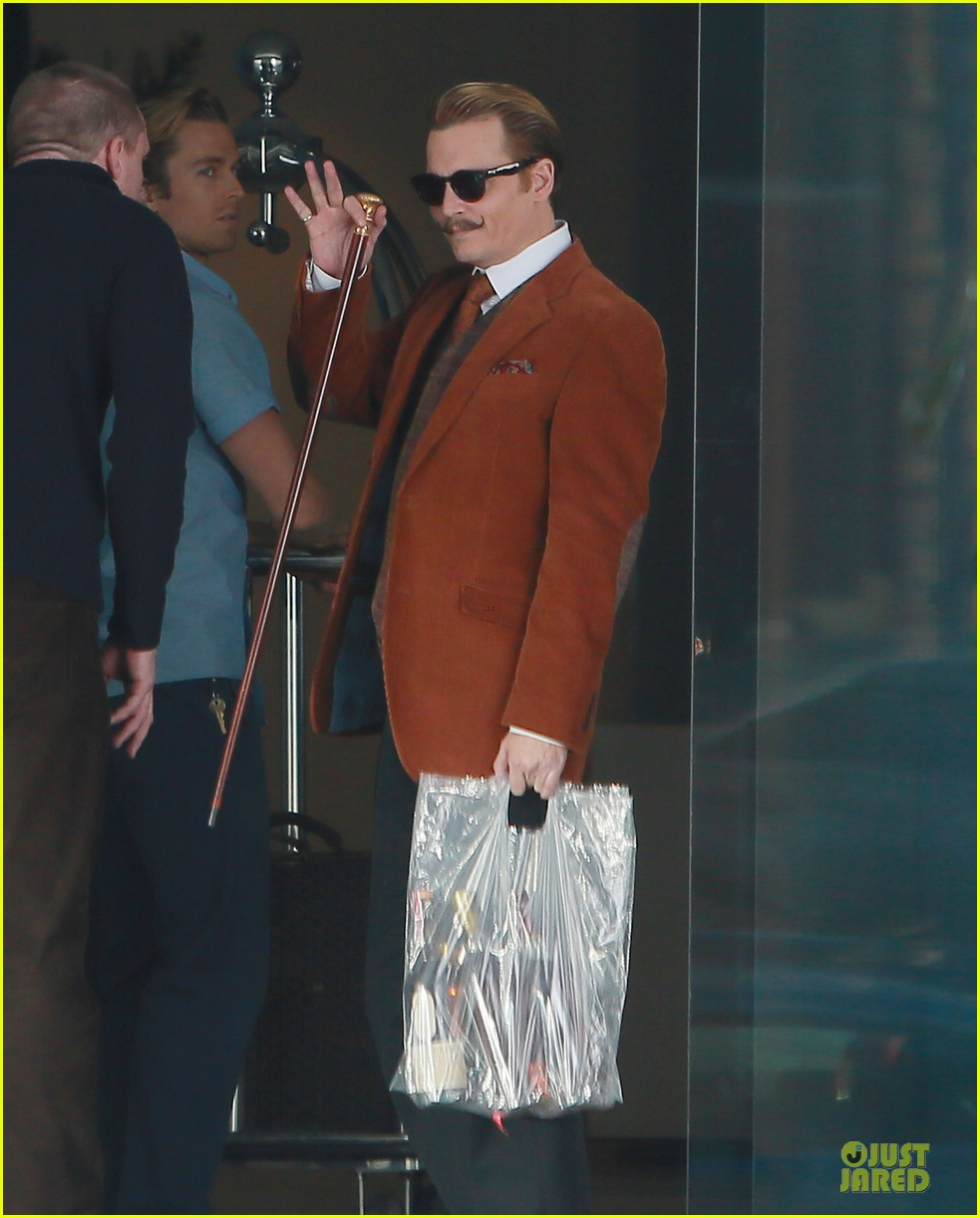 johnny depp mortdecai set with bikini clad babes 083024200