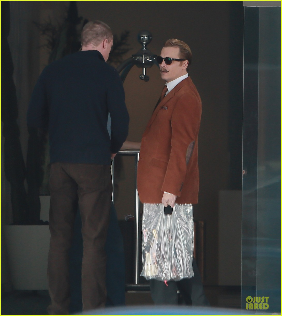 johnny depp mortdecai set with bikini clad babes 10