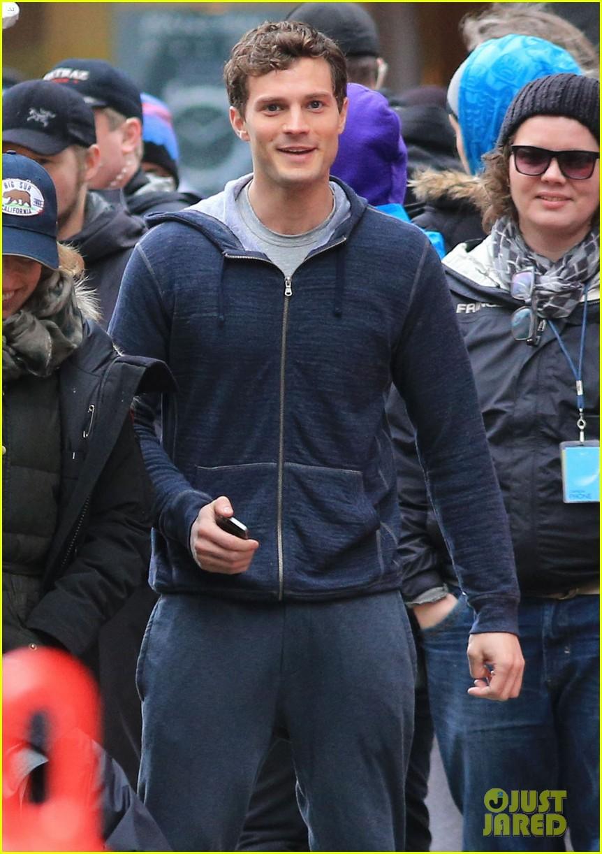jamie dornan runs in the rain for fifty shades of grey 043043901