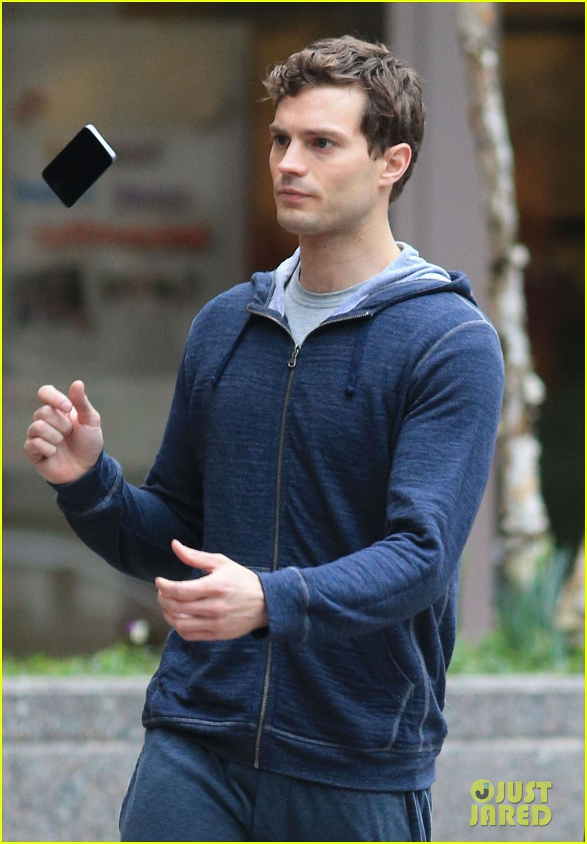jamie dornan runs in the rain for fifty shades of grey 073043904