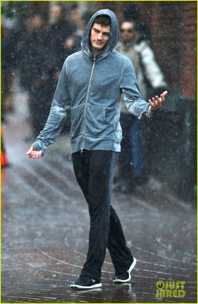 jamie dornan runs in the rain for fifty shades of grey 213043918