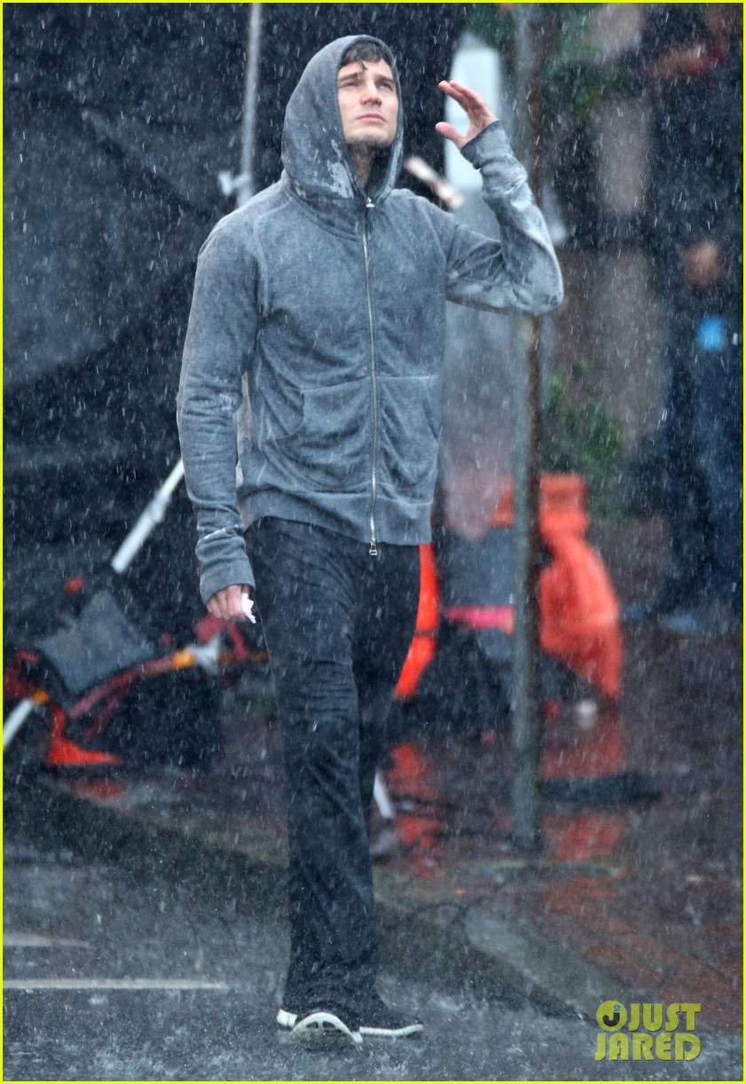 jamie dornan runs in the rain for fifty shades of grey 223043919