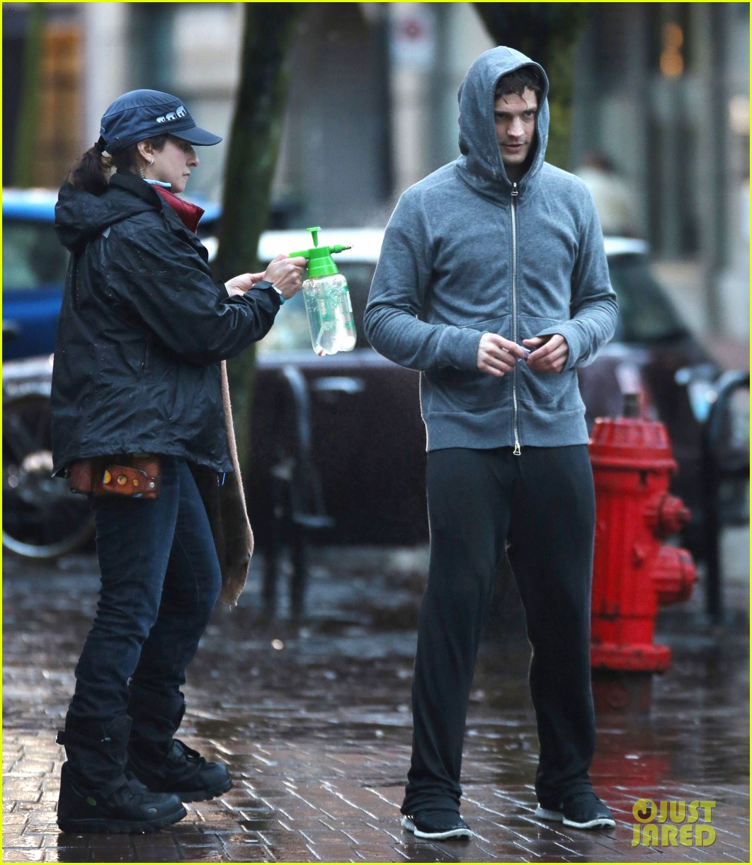 jamie dornan runs in the rain for fifty shades of grey 263043923