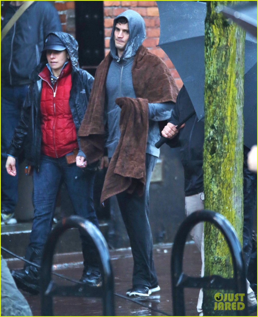 jamie dornan runs in the rain for fifty shades of grey 313043928