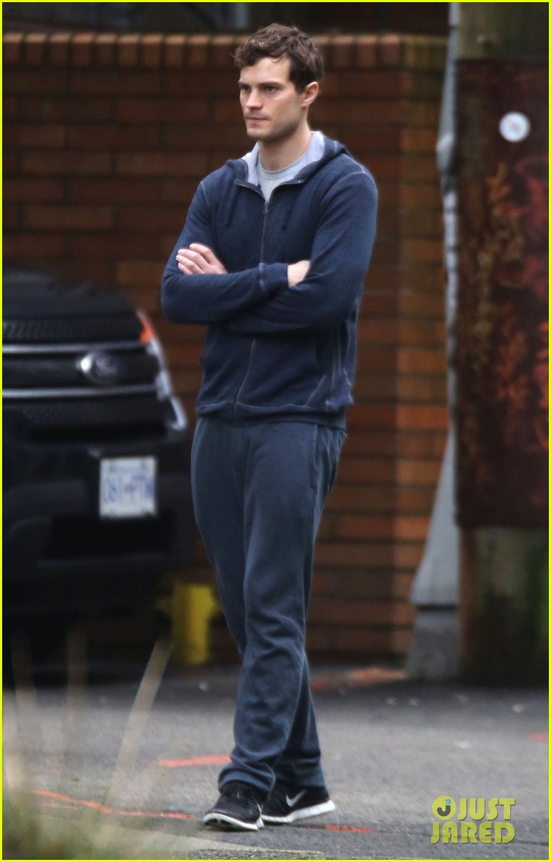 jamie dornan runs in the rain for fifty shades of grey 333043930