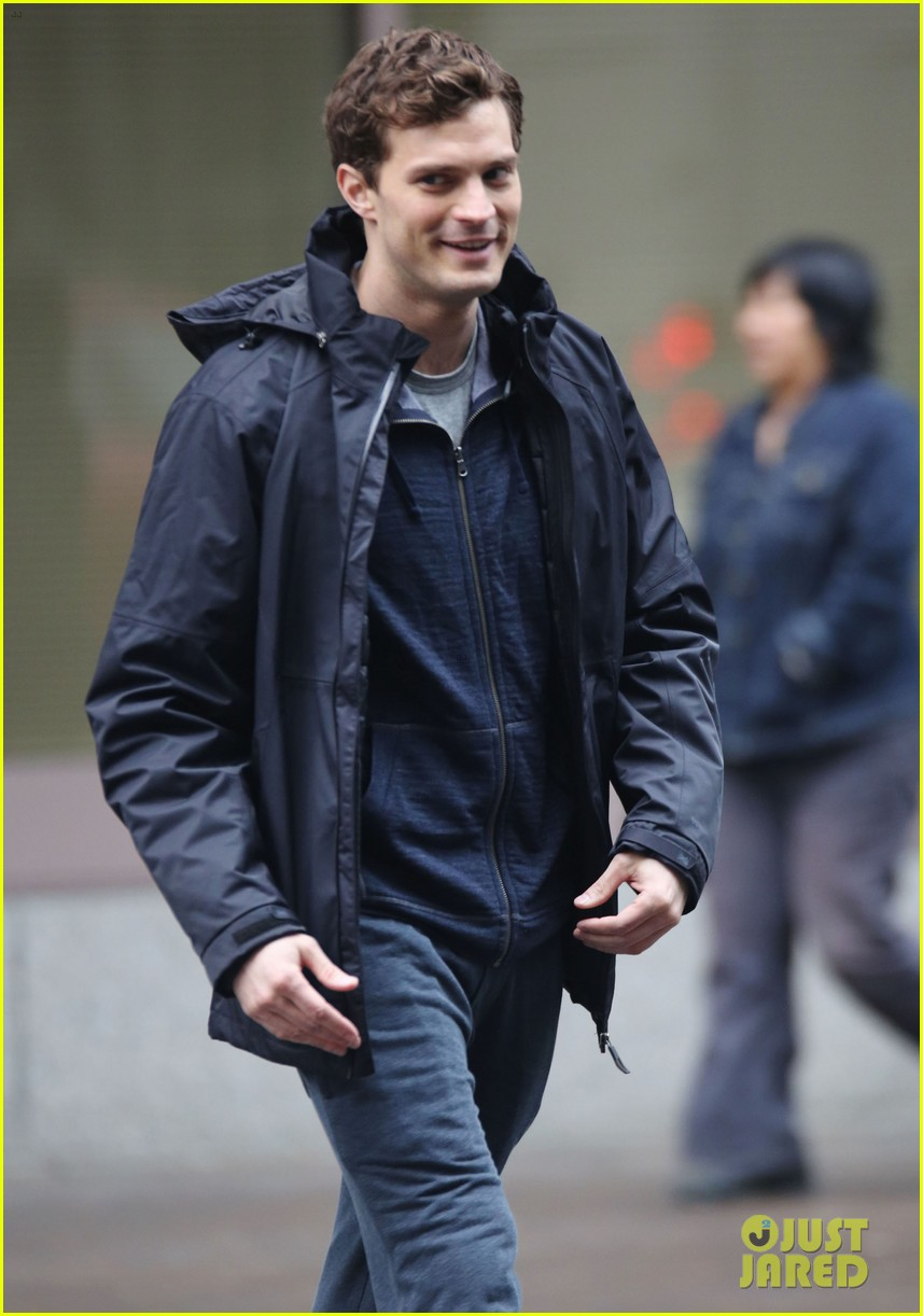 jamie dornan runs in the rain for fifty shades of grey 363043933