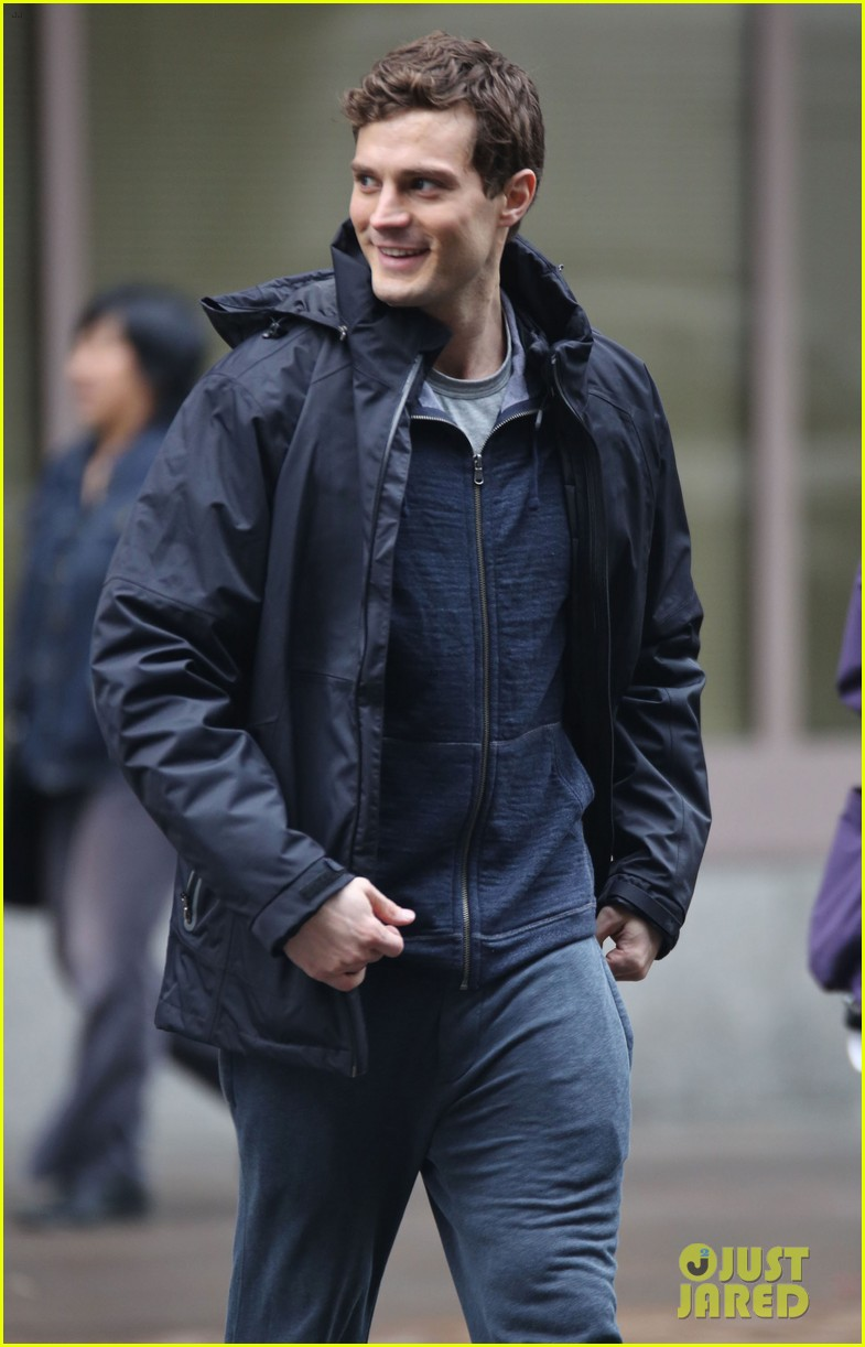 jamie dornan runs in the rain for fifty shades of grey 373043934