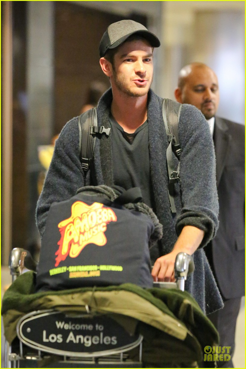 andrew garfield poses with spiderman fan at lax airport 043042308