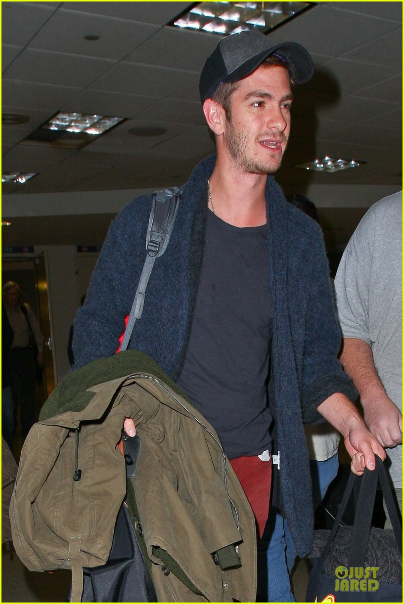andrew garfield poses with spiderman fan at lax airport 063042310