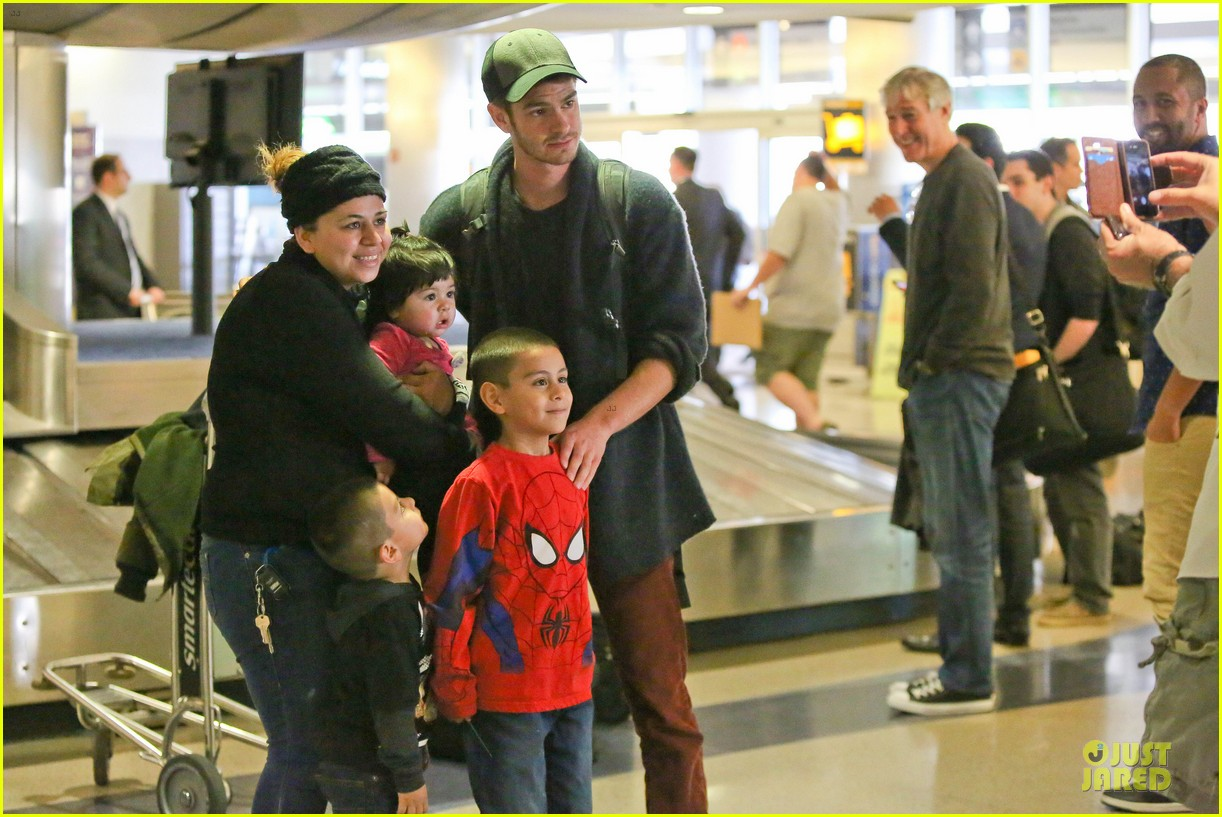 andrew garfield poses with spiderman fan at lax airport 113042315