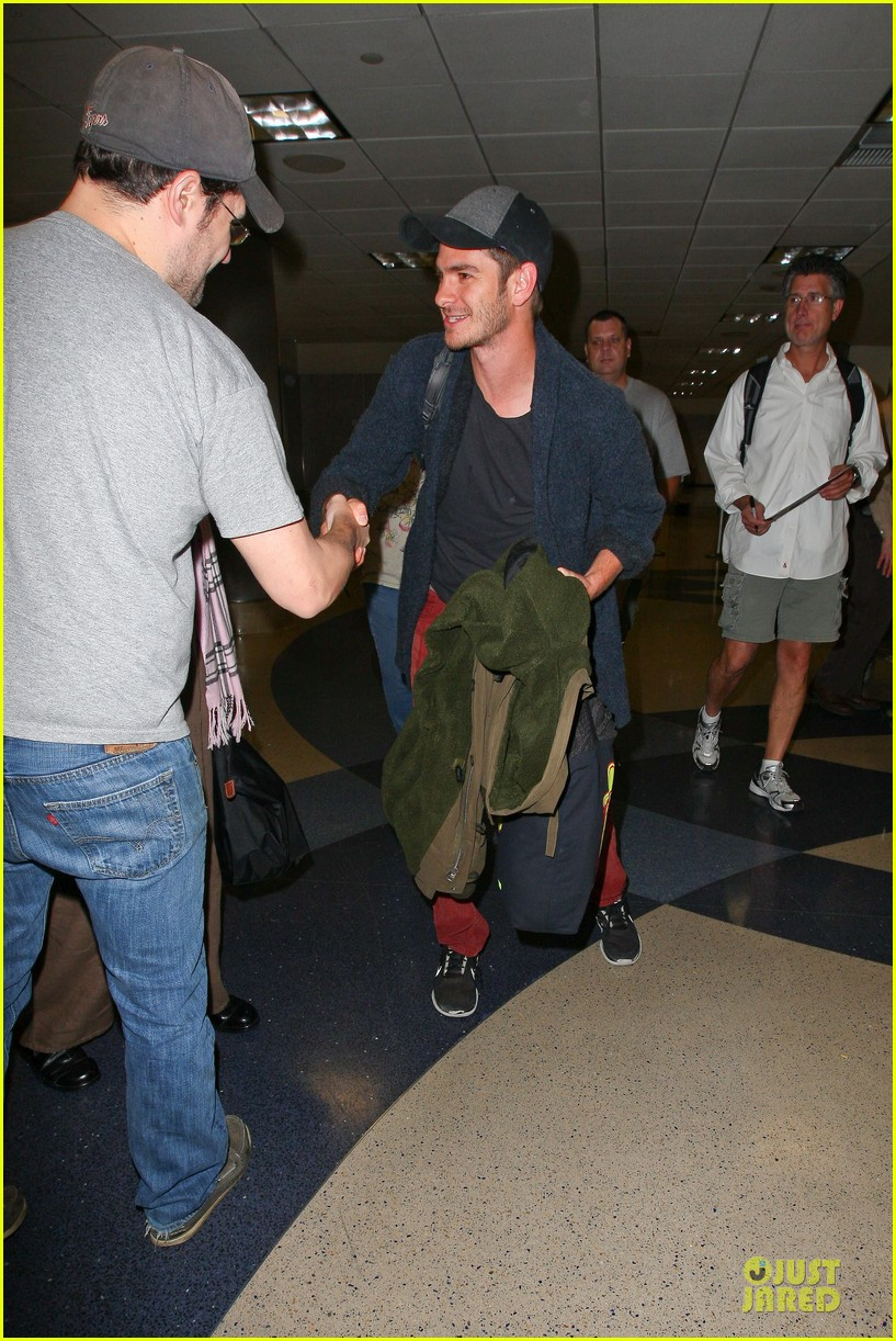 andrew garfield poses with spiderman fan at lax airport 153042319