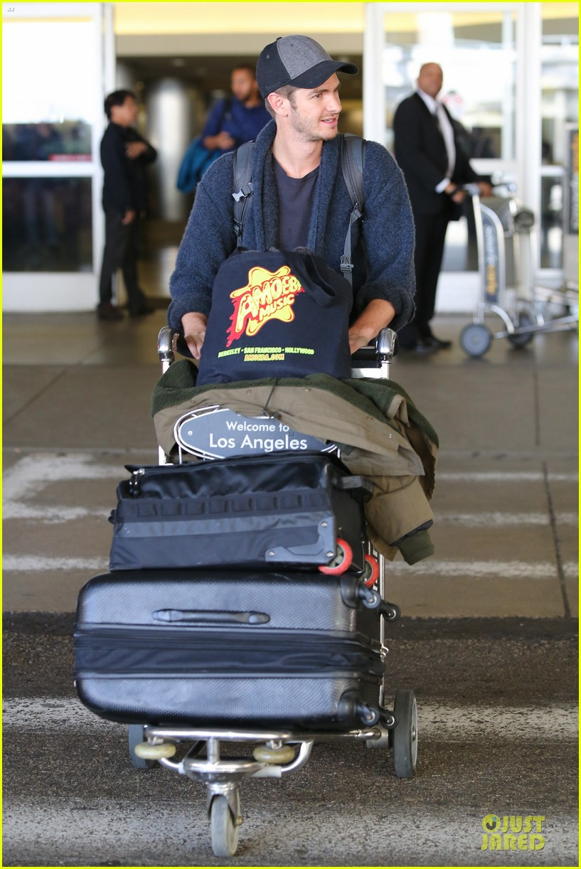andrew garfield poses with spiderman fan at lax airport 213042325