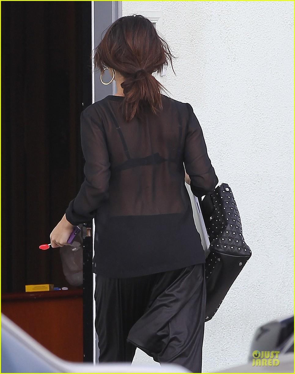 selena gomez flashes black bra in sheer sexy top 04