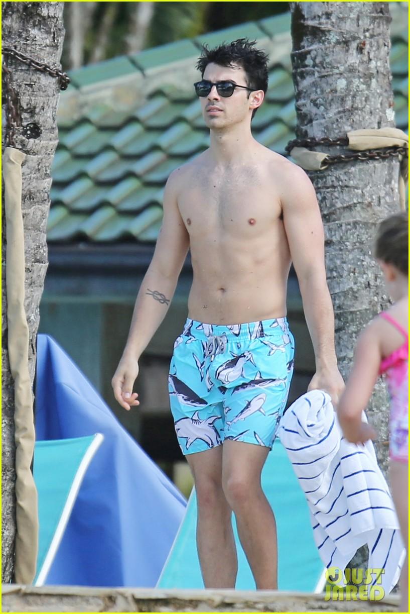 joe jonas shirtless beach frisbee player in hawaii 153023740