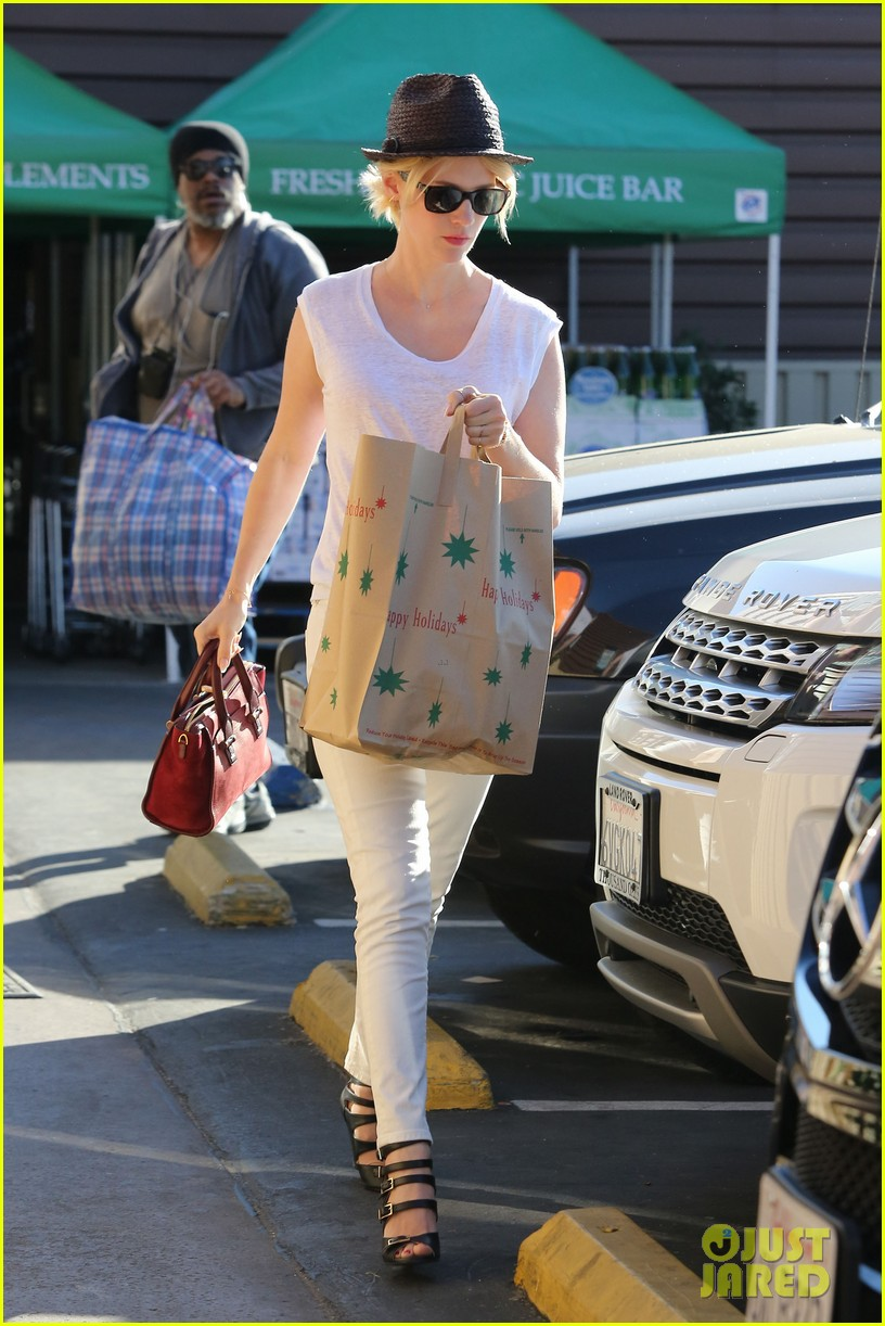 january jones vision in white for shopping trip 173032612
