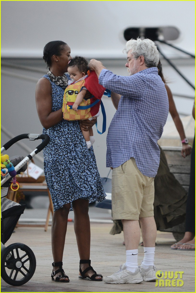 george lucas shows off baby everest on new years vacation 043021568