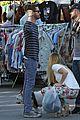aaron paul wife lauren kiss cuddle at the flea market 17