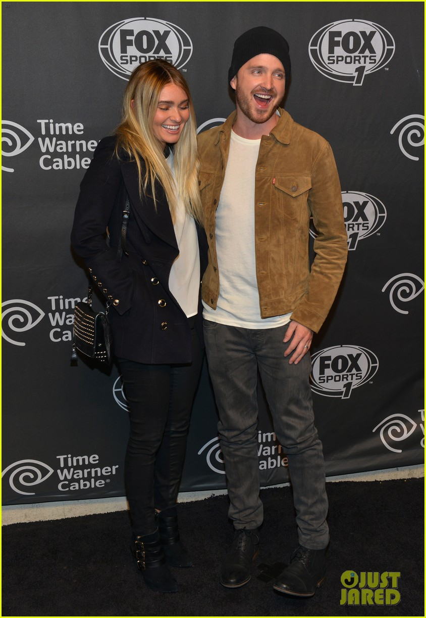 aaron paul kicks his heels up his wife seems unimpressed 083044677