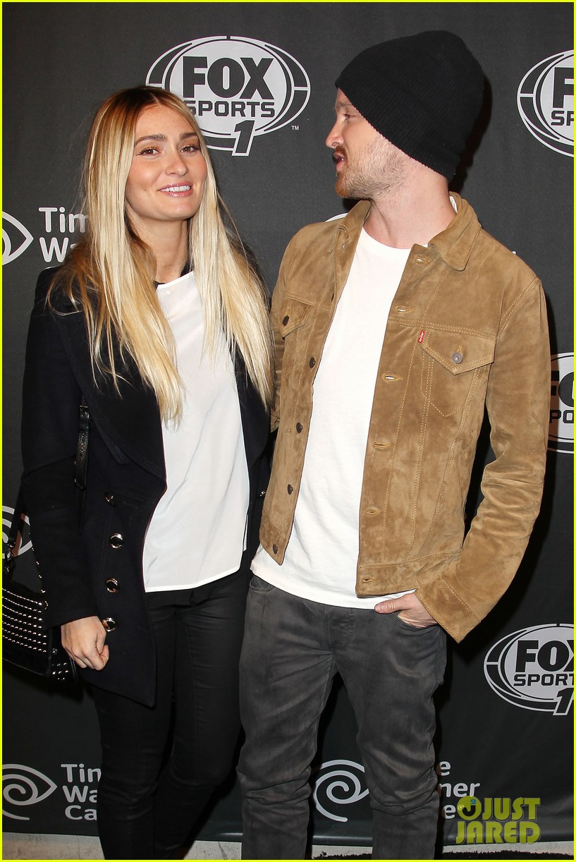 aaron paul kicks his heels up his wife seems unimpressed 203044689
