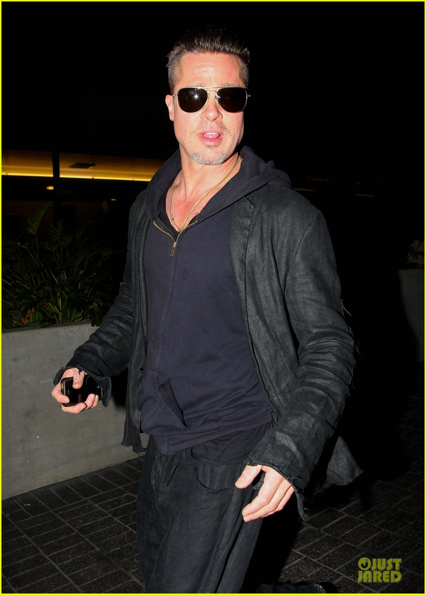 brad pitt lax arrival after angelina jolie difret news 023034038