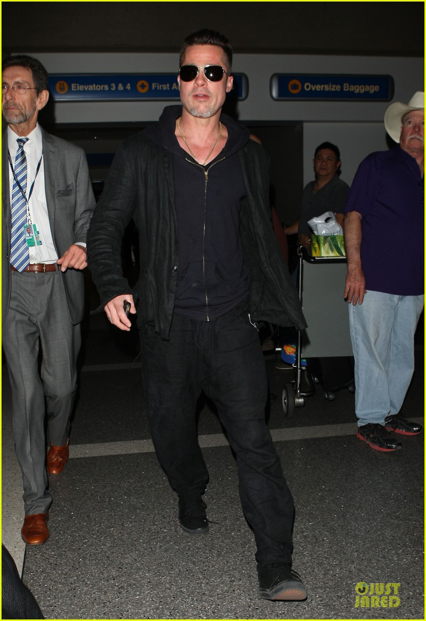 brad pitt lax arrival after angelina jolie difret news 11