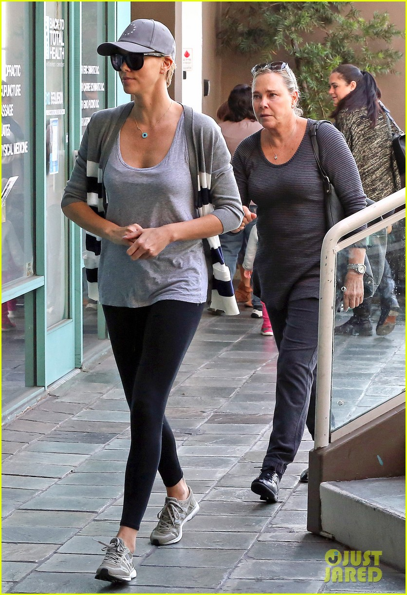 charlize theron takes caped crusader jackson to the gym 063025337