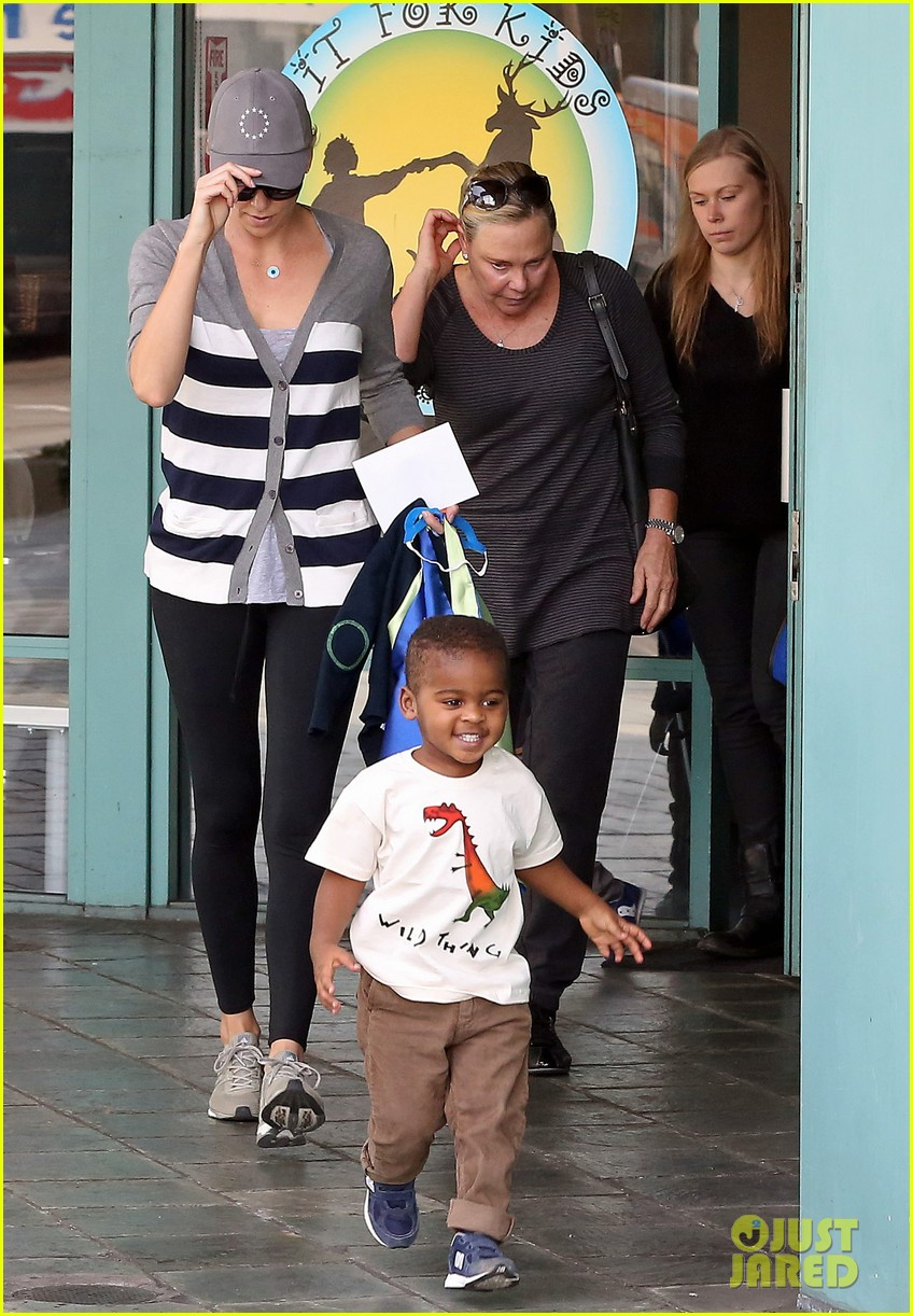 charlize theron takes caped crusader jackson to the gym 08