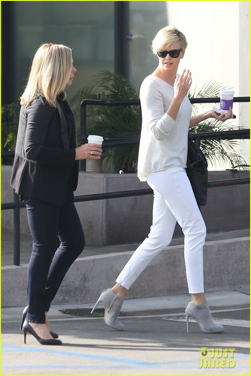 charlize theron vision in white for coffee run 013027198