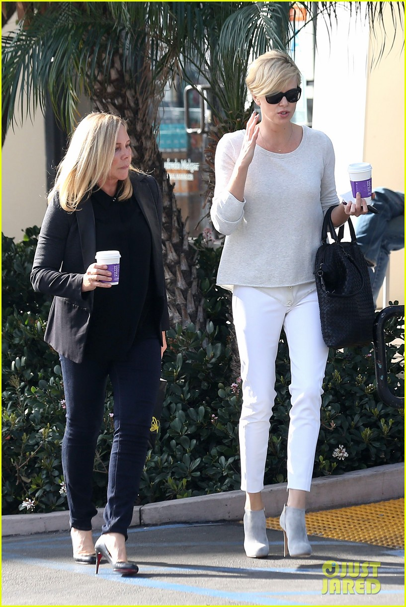 charlize theron vision in white for coffee run 033027200