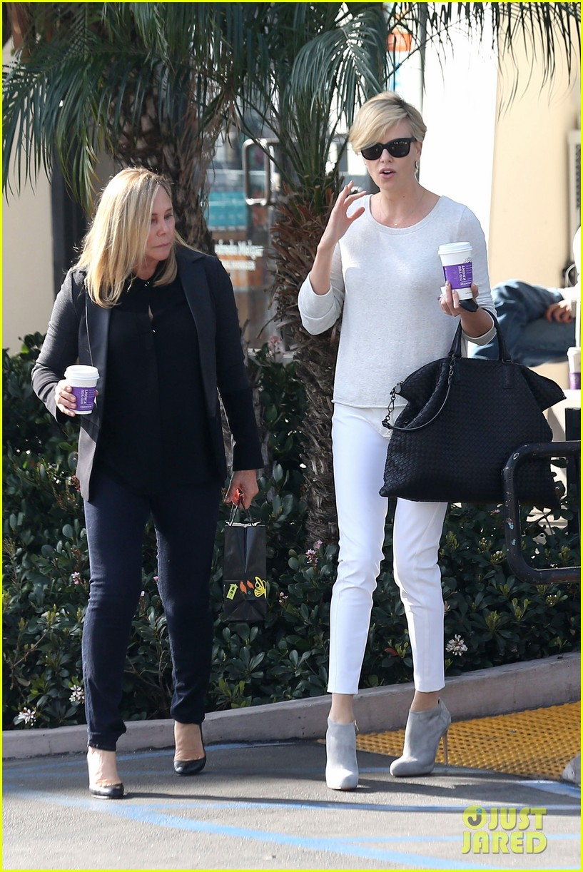 charlize theron vision in white for coffee run 063027203