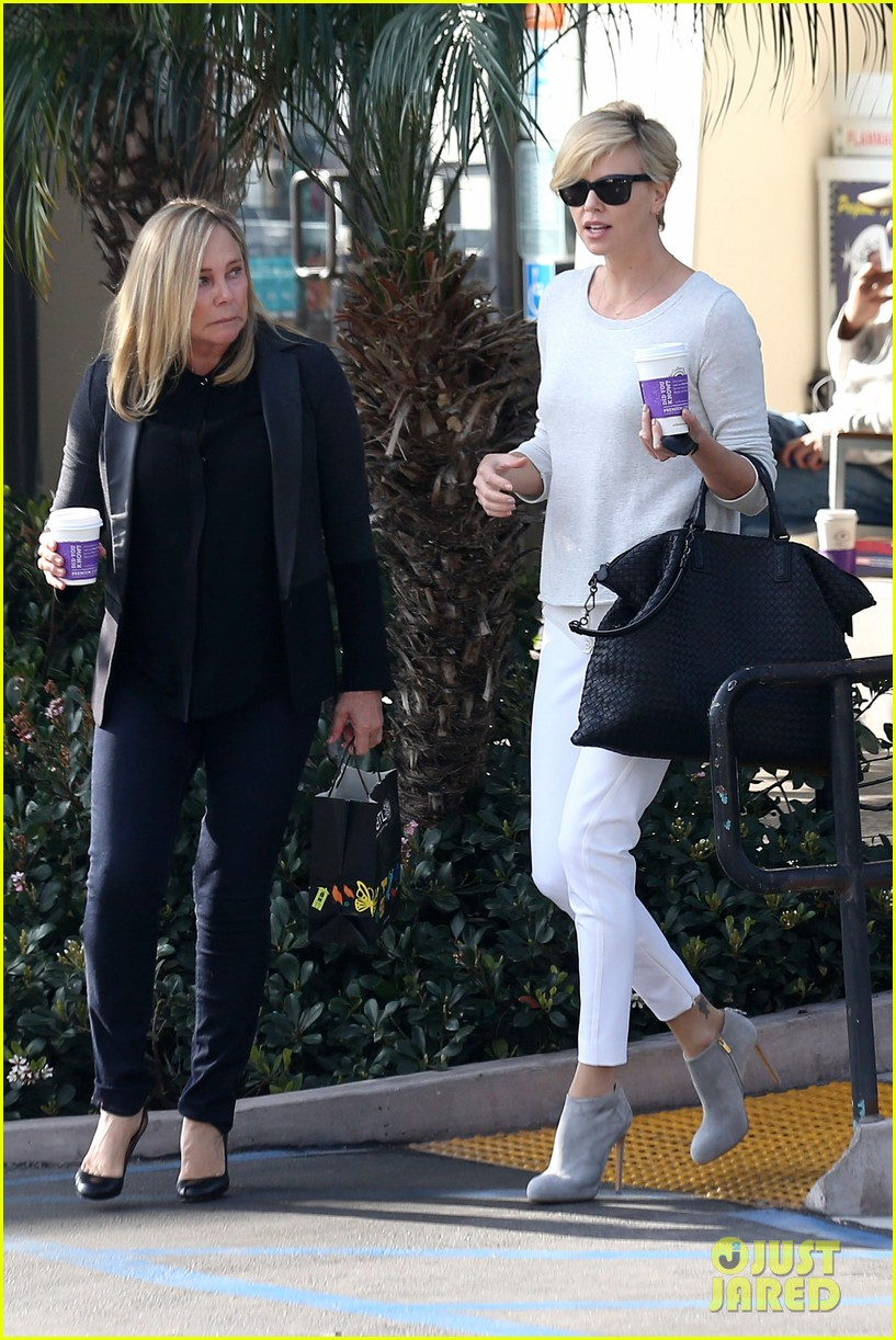 charlize theron vision in white for coffee run 073027204