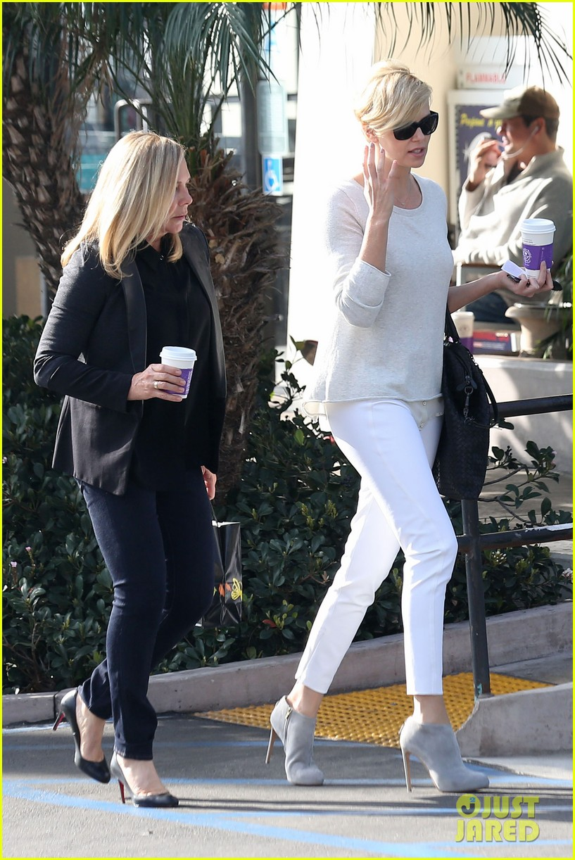 charlize theron vision in white for coffee run 093027206