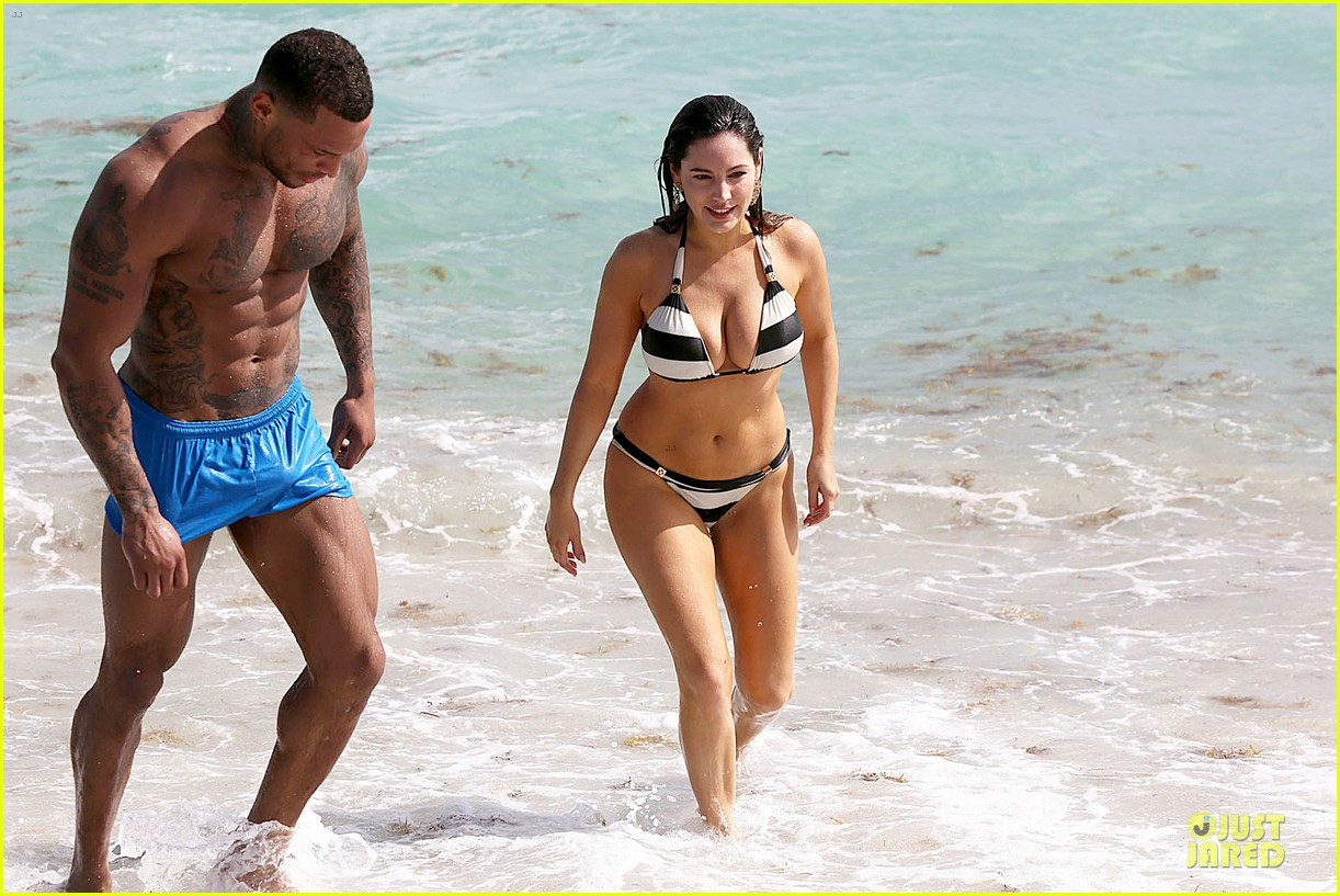 kelly brook frolicks on the beach with boyfriend david mcintosh 113047541