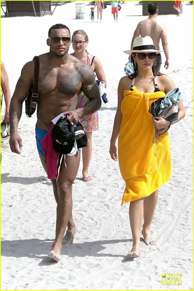 kelly brook frolicks on the beach with boyfriend david mcintosh 133047543