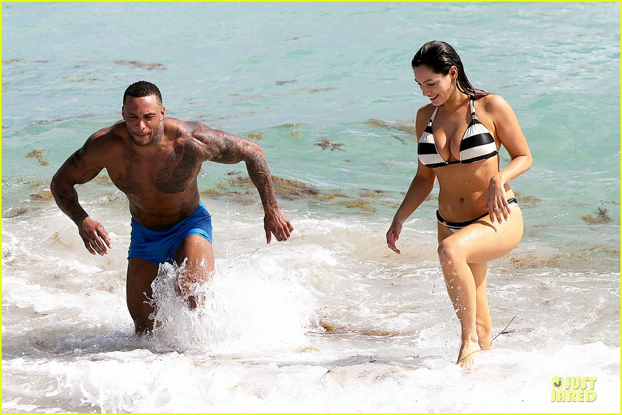 kelly brook frolicks on the beach with boyfriend david mcintosh 163047546