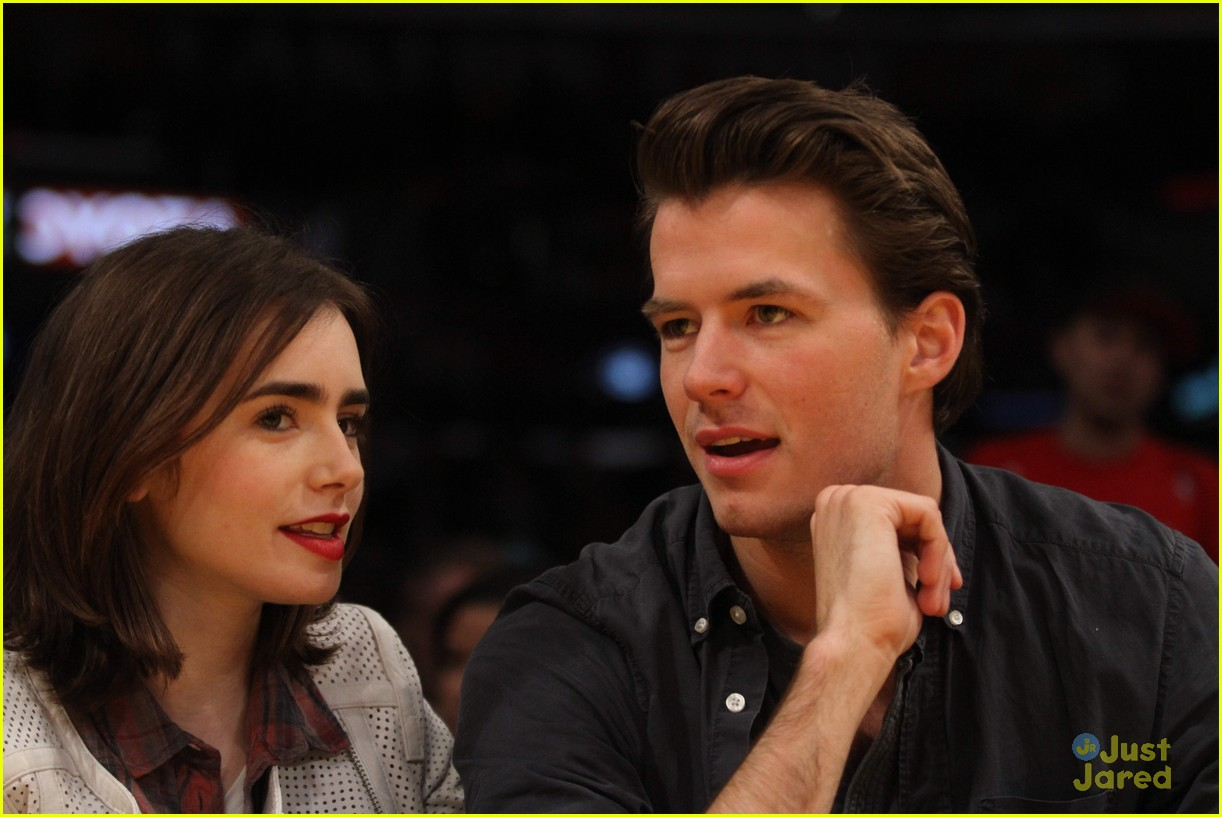 lily collins boyfriend thomas cocquerel hold hands at lakers game 013050573