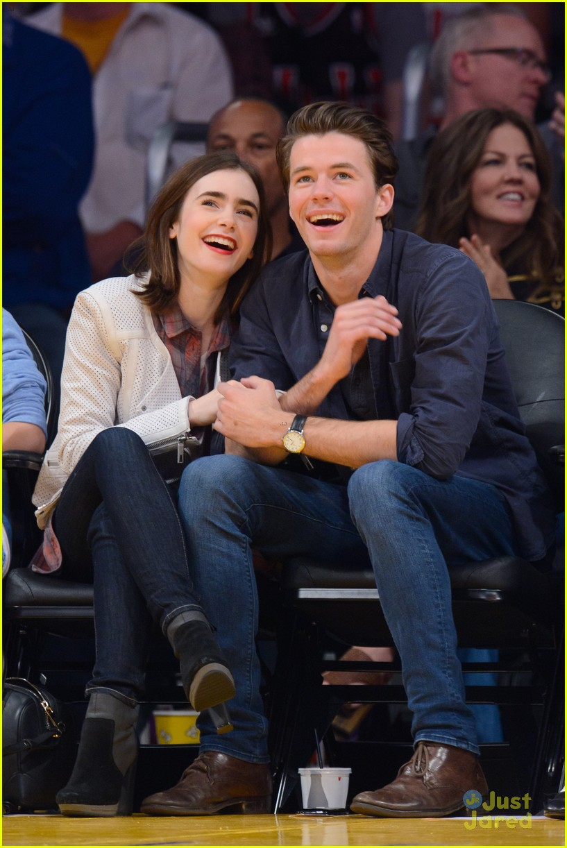 lily collins boyfriend thomas cocquerel hold hands at lakers game 023050574