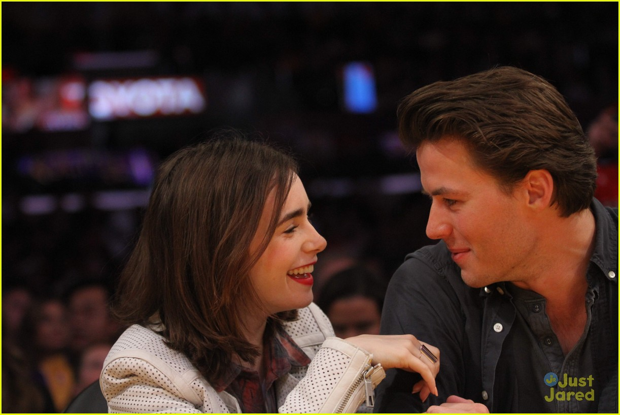 lily collins boyfriend thomas cocquerel hold hands at lakers game 033050575