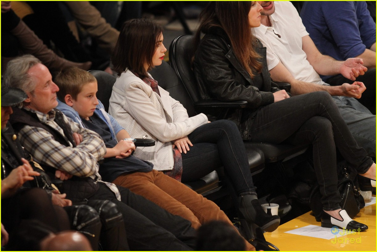lily collins boyfriend thomas cocquerel hold hands at lakers game 043050576