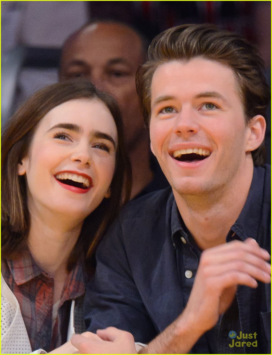 lily collins boyfriend thomas cocquerel hold hands at lakers game 053050577