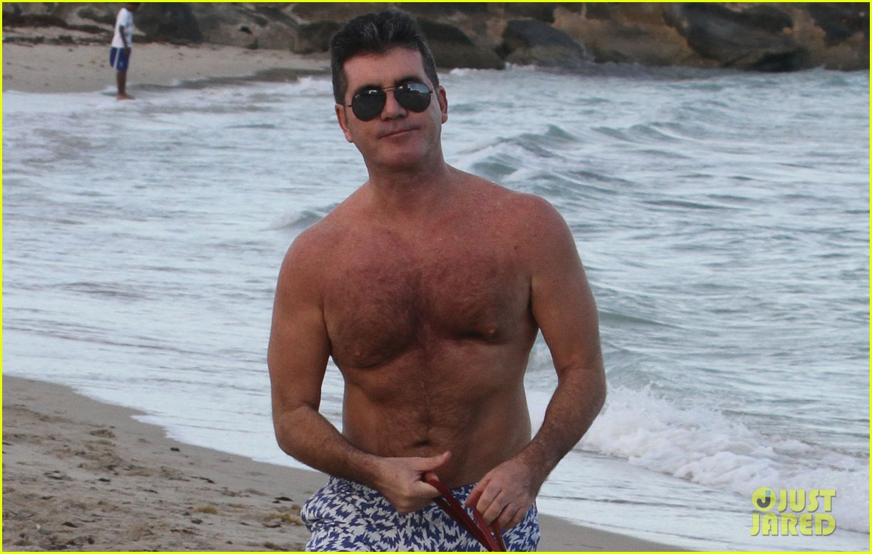 shirtless simon cowell tends to his cute pups on miami vacation 023059469