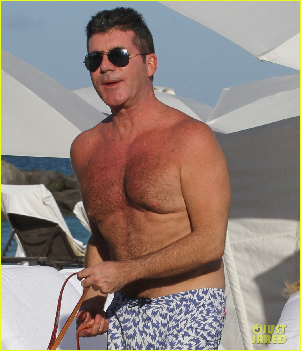 shirtless simon cowell tends to his cute pups on miami vacation 043059471
