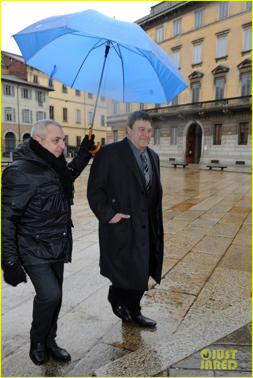 matt damon george clooney get personal umbrella holders in milan 033050711
