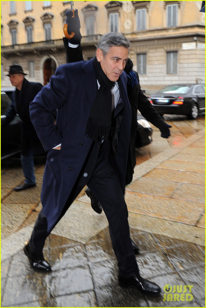 matt damon george clooney get personal umbrella holders in milan 053050713