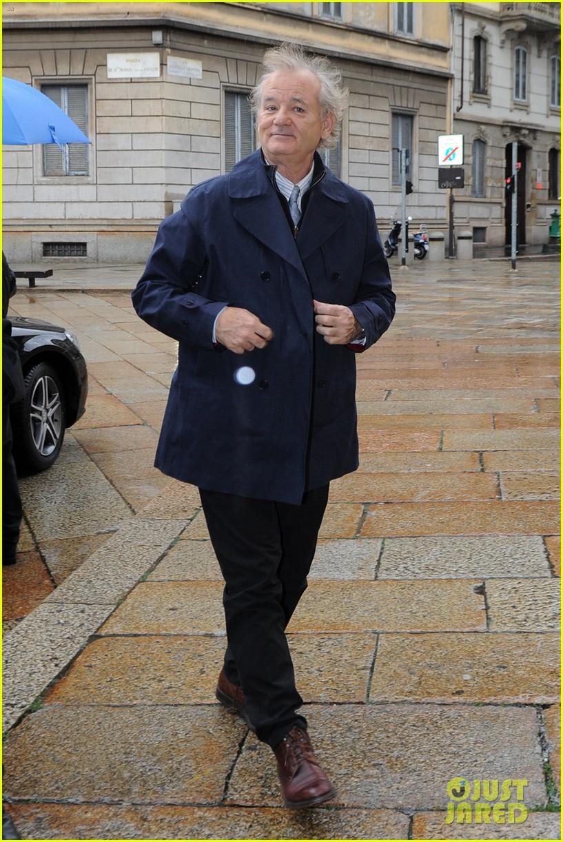 matt damon george clooney get personal umbrella holders in milan 063050714