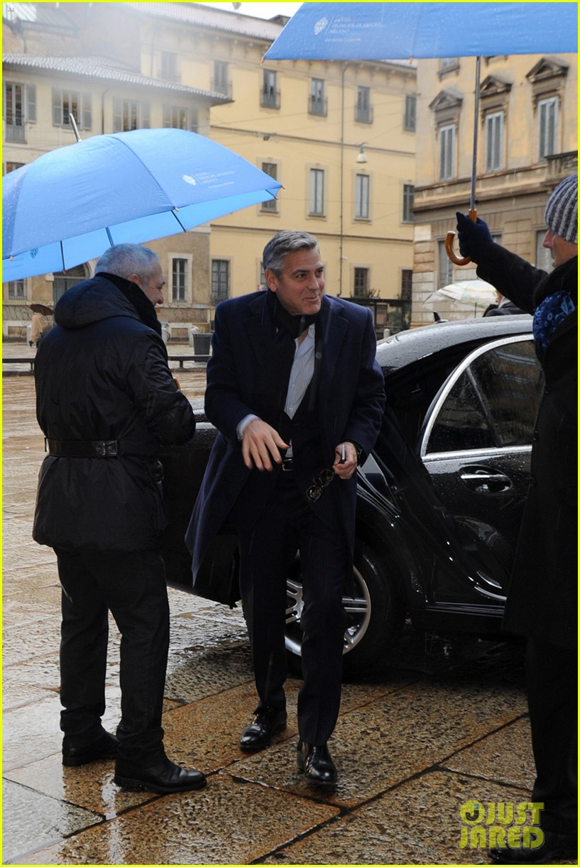 matt damon george clooney get personal umbrella holders in milan 113050719