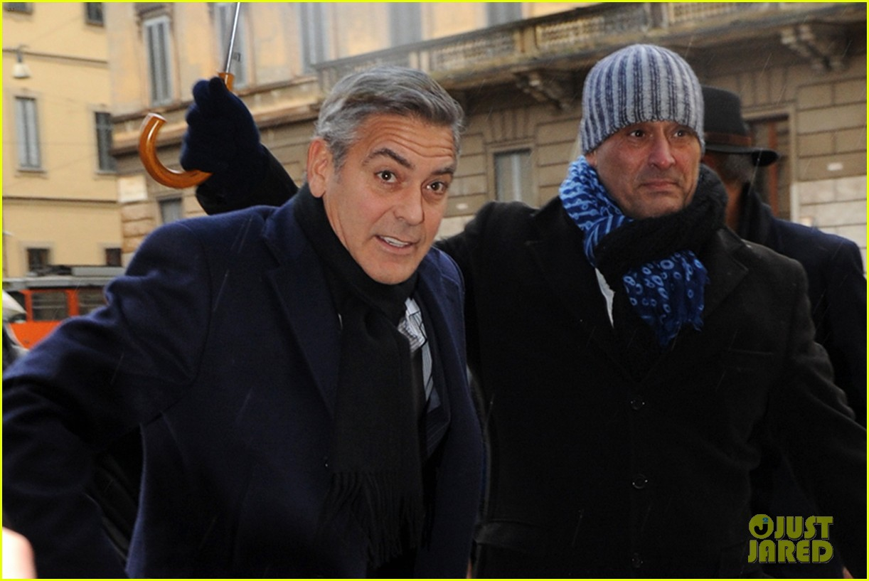 matt damon george clooney get personal umbrella holders in milan 133050721